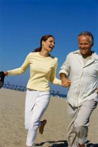 Middle-aged Couple Running on the Beach